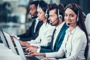 Multicultural young happy employees in call center